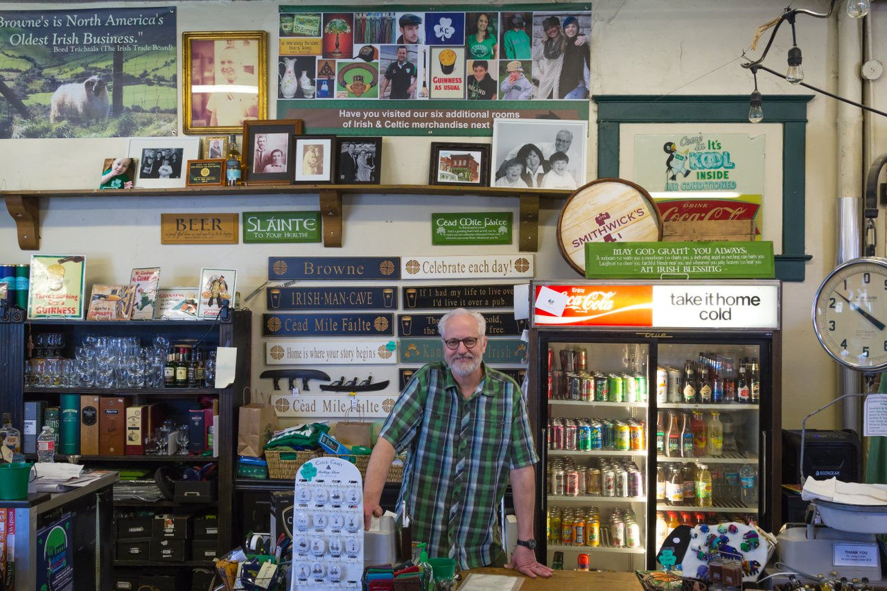 """Browne's owner, John, showing off the """"Oldest Irish business in North  America."""""""